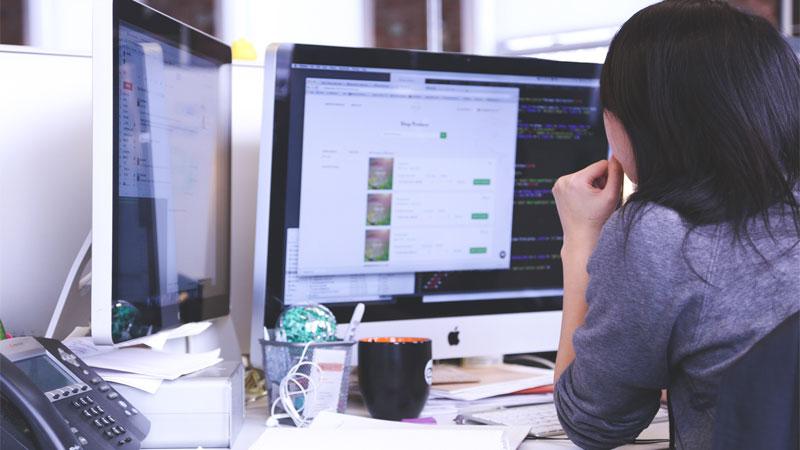 woman using a desktop computer